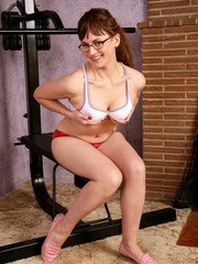 Older woman Sofia Rodas displays her all natural pussy wearing glasses