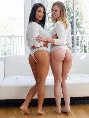 Lesbians Lucy Tyler and Adriana Chechik get into a 69 to lick pussy