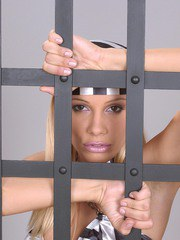Blonde MILF Sandy plays solo anal games in her prison cell with a sex toy
