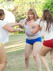 MILF Micky Bells and her BBW gfs free hooters from wet T-shirts in backyard