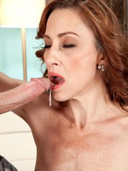 Skinny older redhead Betty Blaze sucks the sperm out of a long penis