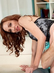 Thin mature redhead Betty Blaze welcomes the sexual advances of a younger boy