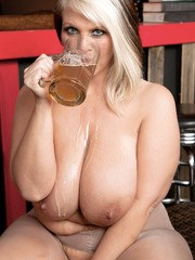 Older BBW Channel Sweets drinks a beer after jerking off a cock