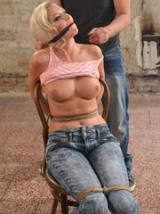 Blonde female Karol gets tied up with rope before having her big tits groped