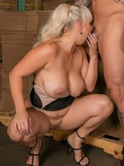 Big titted blonde Nina Kayy sucks a dick with her legs spread open
