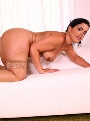 Older housewife Monte Swinger strips off her skirt and pretties to pose nude