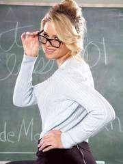 Sexy blonde teacher Jessa Rhodes removes her glasses and then her clothing
