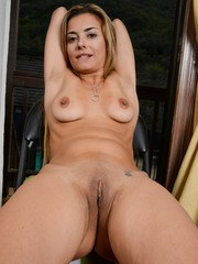 Older solo model Alana Luv releases her camel toe pussy from her white panties