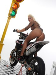 Solo model Ionella Dantes climbs on motorcycle in crotchless bodystocking
