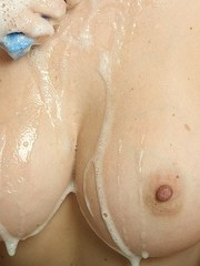 Cute MILF Mandy Sweet soaps up her nice melons in the bathroom