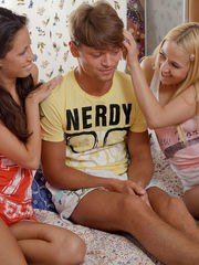 Young girls Anabela and Milana give a nerdy boy his first blowjob
