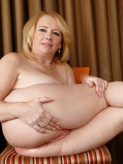 Overweight mature dame Brandie Sweet parts her labia lips after getting naked