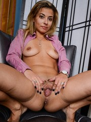 Mature businesswoman Alana Luv gets horny and proceeds to play with her pussy