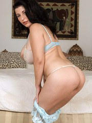 Brunette model Natalie Fiore sets her nice melons free from see thru lingerie