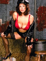 Brunette female with huge boobs ditches her latex cap and skirt