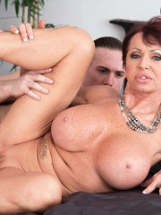 Big titted gran Gina Milano opens wide for a cumshot after fucking her boy toy