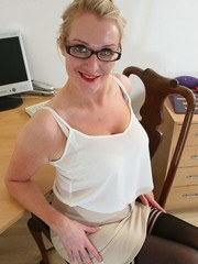 Mature office worker strips down to her stockings and glasses on security cam