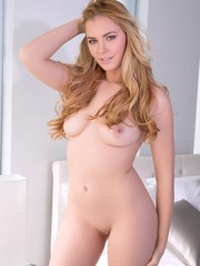 Gorgeous female Bailey Rayne shows off her hot body for nude centerfold shoot