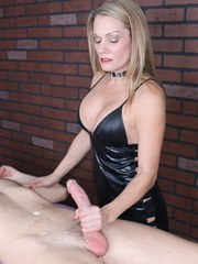 Clothed blond lady Allura Skye jerks a cock off with help from her riding crop