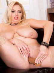 Chunky blonde chick Angel Sweets slips her favourite dildo into her bald pussy