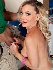 Petite mature woman Diandra greets her male escort with a smile on her face
