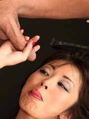 Naked Asian MILF Marica Hase sticks her tongue out for a money shot after a BJ