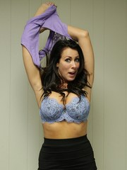 MILF Reagan Foxx shpws some leg in a black skirt before stripping naked