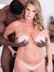 Nude mature woman Candace Harley sucks a BBC and its associated nut sac