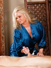 Chubby mature massage therapist Maya Devine seduces a young male client