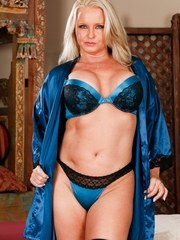 Thick mature woman Maya Devine strips off pretties and robe to rock it in hose