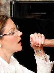 Brunette mom in glasses takes over giving a BJ after instructing her daughter