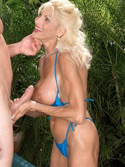 Blonde granny Sasha Samuels seduces a man with a big dick in a wading pool