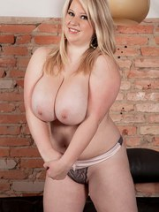 Fat solo model Janne Hollan bares her hooters before getting fully naked
