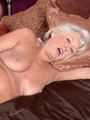 Horny granny Jeannie Lou is ready for anal games in crotchless panties