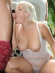 Short haired plumper Marilyn Mandala deepthroats a cock in a see thru onesie