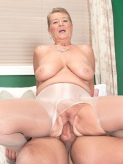 Naughty granny Joanne Price bangs her boy toy wearing crotchless hose