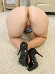 Middle aged brunette Louise Bassett strips to tan stockings and high heels