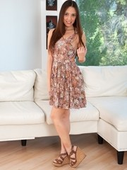 Sweet teen girl Jenna Sativa takes off her dress and panties afore open window