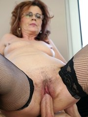 Horny granny Mayna May bangs her boy toys big cock in glasses and mesh hose