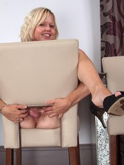 Mature blonde lady Sophie stretches her pussy lips after removing her clothes