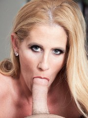 Older blonde lady Sasha Bell sucks a younger guys cock after she seduces him