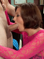 Hot nan Yasmine Beale seduces a much younger man in a long black skirt