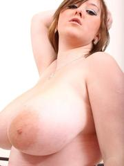 Teen plumper Malibu Candi exposes her huge boobs as she undresses on her bed