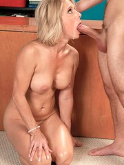Blonde cougar Jenny Mason sucks a young boys dick in the nude