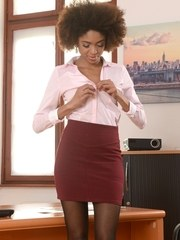 Black female Luna Corazon strips down to her black nylons at her office desk