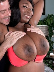 Thick black chick Marie Leone flashes her massive boobs to seduce a white guy