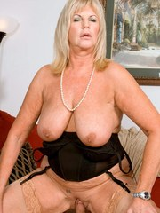 Chunky granny Anneke Nordstrum rides her younger lover in tan nylons