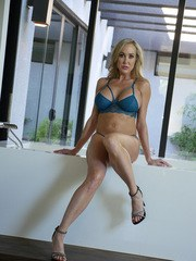 Blonde MILF Brandi Love removes her lingerie and soaps up in a bathtub