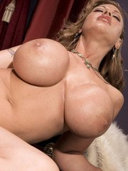 Solo model Crystal Gunns unveils her big round boobs in her dressing room
