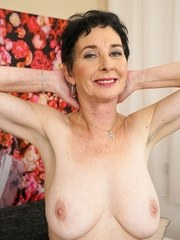 Grandmother Pixie bare her big saggy boobs as she gets totally naked